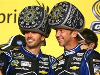 Nov 17, 2013; Homestead, FL, USA; NASCAR Sprint Cup Series driver Jimmie Johnson (left) celebrates with crew chief Chad Knaus after winning his sixth NASCAR championship following the Ford EcoBoost 400 at Homestead-Miami Speedway. Mandatory Credit: Mark J. Rebilas-USA TODAY Sports - RTX15HY9