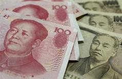 Yuan and Yen banknotes are seen in this picture illustration taken in Tokyo May 29, 2012. REUTERS/Issei Kato