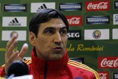 Romania's national soccer team coach Victor Piturca attends a news conference in Mogosoaia, near Bucharest, November 18, 2013. REUTERS/Bogdan Cristel