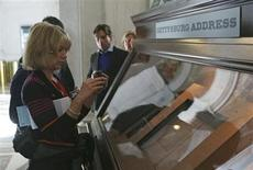 A woman photographs the Nicolay copy of U.S. President Abraham Lincoln's Gettysburg Address speech at the Library of Congress in Washington November 11, 2013. REUTERS/Gary Cameron