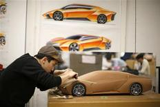 Junghan Kim, 22, from South Korea, works on a clay design for a 2023 Lamborghini during a Transportation Design class at Art Center College of Design in Pasadena, California November 8, 2013. REUTERS/Lucy Nicholson