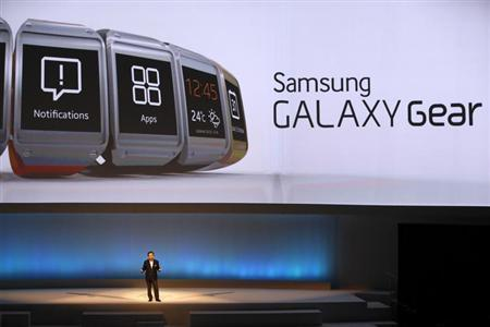 Shin Jong-kyun, President and CEO, head of IT and Mobile Communication division of Samsung presents the Samsung Galaxy Gear smartwatch during its launch at the 'Samsung UNPACKED 2013 Episode 2' at the IFA consumer electronics fair in Berlin, September 4, 2013. REUTERS/Fabrizio Bensch