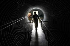 Curator Ruth Pelletier walks down a hallway in the cold-war era nuclear fallout shelter constructed for President John F. Kennedy on Peanut Island near Riviera Beach, Florida November 8, 2013. REUTERS/Joe Skipper