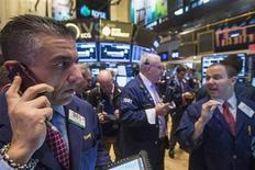 Traders work on the floor of the New York Stock Exchange, November 19, 2013. REUTERS/Brendan McDermid