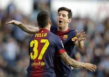 Barcelona's Cristian Tello (L) celebrates his goal against Celta Vigo with teammate Lionel Messi during their Spanish First Division soccer match at the Balaidos stadium in Vigo March 30, 2013. REUTERS/Miguel Vidal