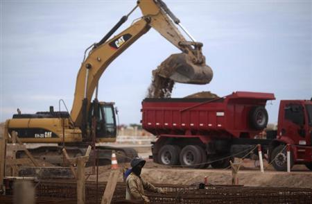 A worker is pictured at the construction site of Port of Acu in Sao Joao da Barra March 11, 2013. REUTERS/Ricardo Moraes