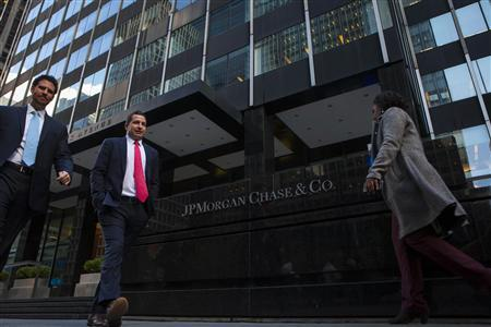 People walk by the JP Morgan & Chase Co. building in New York in this file photo from October 24, 2013. REUTERS/Eric Thayer/Files