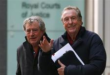 "Monty Python members Eric Idle (R) and Terry Jones leave the High Court during a lunch break in central London December 4, 2012. Three members of Monty Python are being sued by one of the producers of their film ""Monty Python and the Holy Grail"". The Pythons are at odds with Mark Forstater, the producer of the ""Holy Grail"", who says he has not received his fair share of profits from ""Spamalot"", a spin-off musical. REUTERS/Andrew Winning"