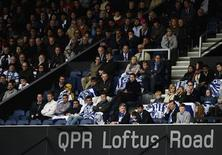 Queens Park Rangers' fans watch their team take on Newcastle United during their English Premier League soccer match at Loftus Road in London May 12, 2013. REUTERS/Dylan Martinez