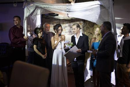 Bride Veronica 4th L Reads A Message To Her Groom Michael R As They Stand Underneath Traditional Jewish Wedding Canopy During Their Secular