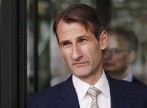 Ben Story, head of UK investment banking & broking at Citibank leaves Portcullis House, in central London November 20, 2013. REUTERS/Luke MacGregor