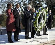 U.S. President Barack Obama (2nd L), first lady Michelle Obama (L), former President Bill Clinton (3rd L) and Hillary Clinton participate in a wreath laying in honor of assassinated U.S. President John F. Kennedy at Arlington National Cemetery, near Washington, November 20, 2013. REUTERS/Jason Reed
