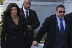 "Teresa Giudice (L), 41, and her husband Giuseppe ""Joe"" Giudice, 43, arrive at the Federal Court in Newark, New Jersey, November 20, 2013. REUTERS/Eduardo Munoz"