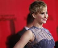 """Cast member Jennifer Lawrence poses at the premiere of """"The Hunger Games: Catching Fire"""" in Los Angeles, California November 18, 2013. REUTERS/Mario Anzuoni"""