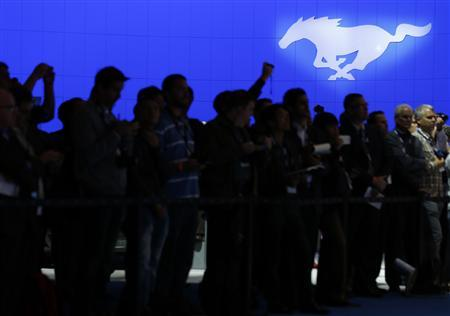 The Ford motor company logo for their Mustang brand is shown above attendees at the 2013 Los Angeles Auto Show in Los Angeles, California November 20, 2013. REUTERS/Mike Blake