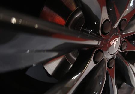 A logo of Tesla Motor Inc is seen on the wheel of its Model S car, on display at the 43rd Tokyo Motor Show November 20, 2013. REUTERS/Yuya Shino