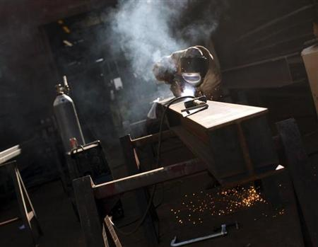 A welder works on a beam at a welding company in San Francisco, California January 10, 2013. REUTERS/Robert Galbraith