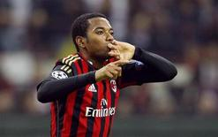 AC Milan's Robinho celebrates after scoring against Barcelona during their Champions League soccer match at the San Siro stadium in Milan, October 22, 2013. REUTERS/Alessandro Garofalo
