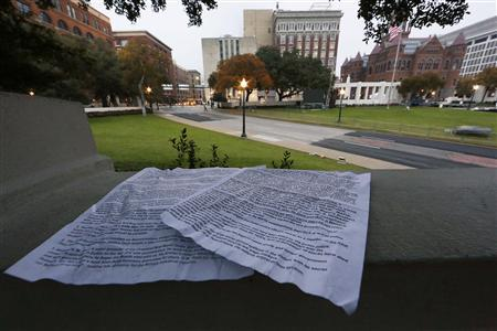 Papers left behind by a conspiracy supporter detailing conspiracy theories about U.S. President John F. Kennedy's 1963 assassination sit atop the ''Grassy Knoll'' in Dealey Plaza looking down on the spot where the president was shot in Dallas, November 21, 2013. REUTERS/Jim Bourg