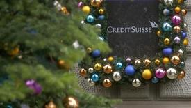 Christmas decoration is placed around the logo of Swiss bank Credit Suisse beside the entrance to its headquarters in Zurich November 21, 2013. REUTERS/Arnd Wiegmann