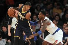 Nov 20, 2013; New York, NY, USA; Indiana Pacers small forward Paul George (24) controls the ball against New York Knicks shooting guard Iman Shumpert (21) during the first quarter at Madison Square Garden. Brad Penner-USA TODAY Sports