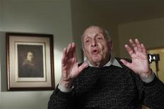 Harry Ettlinger speaks during an interview as a print of a Rembrandt self-portrait hangs on the wall in the background at his home in Rockaway, New Jersey, November 20, 2013. REUTERS/Eduardo Munoz
