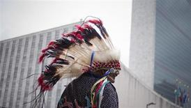 Travis Mazawaficuna of the Dakota Nation (Sioux) Native American tribe is photographed outside the United Nations headquarters after arriving with others on horseback in commemoration of the International Day of the World's Indigenous Peoples in Manhattan, New York on August 9, 2013. REUTERS/Adrees Latif