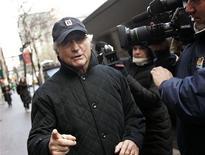 Bernard Madoff walks back to his apartment in New York December 17, 2008. REUTERS/Shannon Stapleton