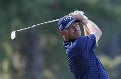 Denmark's Thomas Bjorn tees off on the 11th hole during the first round of the 2013 PGA Championship golf tournament at Oak Hill Country Club in Rochester, New York August 8, 2013. REUTERS/Mathieu Belanger