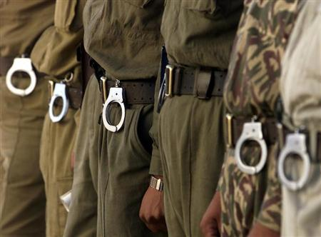 Uzbek prison guards line up in Jaslik jail some 1,000 km west from the capital Tashkent, September 29, 2003. REUTERS/Shamil Zhumatov