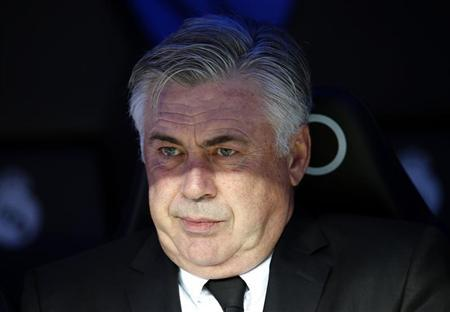 Real Madrid's coach Carlo Ancelotti reacts before their Spanish first division football match against Real Sociedad at Santiago Bernabeu stadium in Madrid November 9, 2013. REUTERS/Sergio Perez