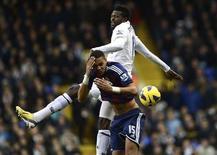 Tottenham Hotspur's Emmanuel Adebayor (R) challenges Stoke City's Steven N'Zonzi during their English Premier League soccer match at White Hart Lane in London December 22, 2012. REUTERS/Dylan Martinez
