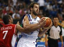 Greece's Vassilis Spanoulis (R) is challenged by Lebanon's Rony Fahed during their basketball game at FIBA Olympic qualifying tournament in Athens July 14, 2008. REUTERS/Yiorgos Karahalis