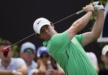 Rory McIlroy of Northern Ireland drives the ball on the second hole during the third round of the DP World Tour Championship in Dubai November 16, 2013. REUTERS/Caren Firouz
