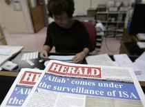 """Herald, the Catholic Weekly,"" is seen on the table at its office in Kuala Lumpur February 27, 2009. REUTERS/Zainal Abd Halim"