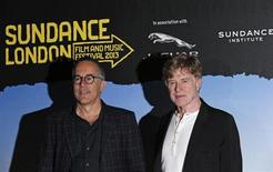 Director of the Sundance Film Festival, John Cooper (L), and President and founder of the Sundance Institute, Robert Redford, pose for photographers during a news conference for Sundance London, at the O2 Arena in London April 24, 2013. REUTERS/Suzanne Plunkett