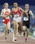 New Zealand's Tim Prendergast (R) competes in the 800 metres final at the eleventh Paralympic Games in Sydney in this file photograph dated October 20, 2000. REUTERS/files