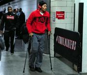 Nov 22, 2013; Portland, OR, USA; Chicago Bulls point guard Derrick Rose (1) walks out of the Moda Center on crutches after being injured in the game against the Portland Trail Blazers. Steve Dykes-USA TODAY Sports