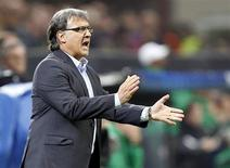 Barcelona's coach Gerardo Martino reacts during their Champions League soccer match against AC Milan at the San Siro stadium in Milan, October 22, 2013. REUTERS/Stefano Rellandini