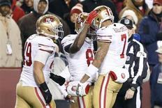 Landover, MD, USA; San Francisco 49ers wide receiver Anquan Boldin (81) celebrates with quarterback Colin Kaepernick (7) after scoring a touchdown against the Washington Redskins in the first quarter at FedEx Field. Geoff Burke-USA TODAY Sports
