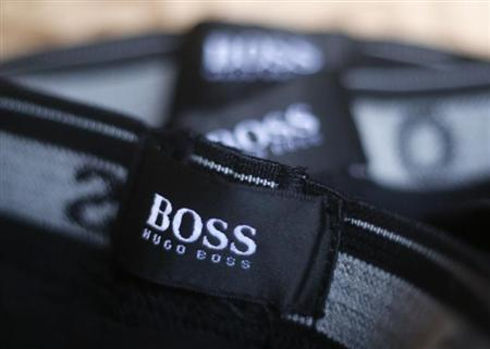 The logo of German fashion house Hugo Boss is seen on a clothing label at their outlet store in Mezingen near Stuttgart October 29, 2013. REUTERS/Michael Dalder