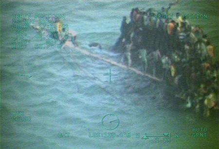 Ten Haitian migrants die, 100 cling to capsized ship in