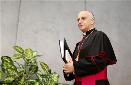 Bishop Rino Fisichella arrives to present Evangelii Gaudium (The Joy of the Gospel) from Pope Francis, during a news conference in Vatican November 26, 2013. REUTERS/Alessandro Bianchi