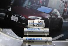 Panasonic Corp's lithium-ion batteries, which are part of Tesla Motor Inc's Model S and Model X battery packs, are displayed in front of a poster of a Tesla Model S during a news conference at the Panasonic Center in Tokyo, ahead of the 2013 Tokyo Motor Show, November 19, 2013. REUTERS/Yuya Shino