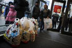 Shoppers wait inside Macy's Manhattan department store in New York, December 26, 2012. REUTERS/Eduardo Munoz