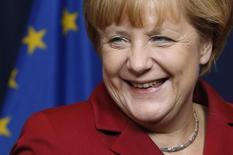 """Канцлер ФРГ Ангела Меркель во время саммита лидеров ЕС в Брюсселе 24 октября 2013 года. Консерваторы канцлера Германии Ангелы Меркель через два месяца после убедительной победы на выборах договорились с левоцентристской партией Социальных демократов (SPD) о формировании """"большой коалиции"""", что означает, что Меркель сможет сформировать правительство к Рождеству. REUTERS/Francois Lenoir"""