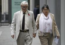 Hotel owners Peter and Hazelmary Bull walk outside a branch of the High Court in central London, November 8, 2011. REUTERS/Andrew Winning