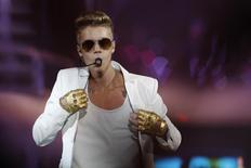 Canadian singer Justin Bieber performs in a concert at the Atlantico pavilion in Lisbon March 11, 2013. REUTERS/Hugo Correia