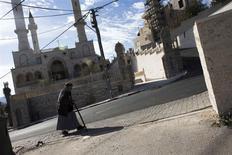 A man walks past a new mosque in the Israeli Arab village of Abu Ghosh, near Jerusalem November 22, 2013. REUTERS/Ronen Zvulun
