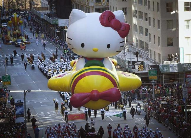 The Hello Kitty balloon float makes its way down 6th Avenue during the 87th Macy's Thanksgiving day parade in New York November 28, 2013. REUTERS/Carlo Allegri